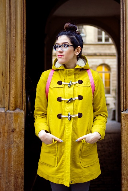 Yellow coat with pink backpack