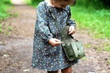 green rain boots, a floral dress and a suede bag