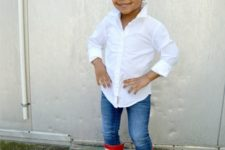jeans, red rain boots, a white shirt