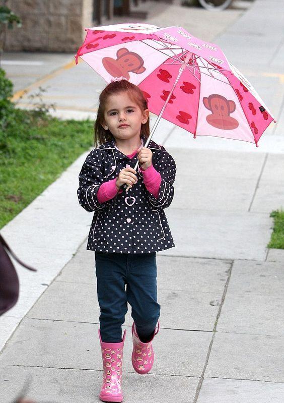 pink boots, jeans, a polka dot coat