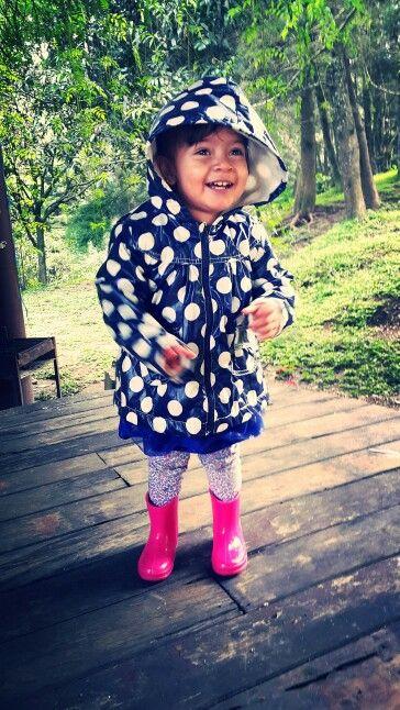 pink hunter boots, a polka dot raincoat