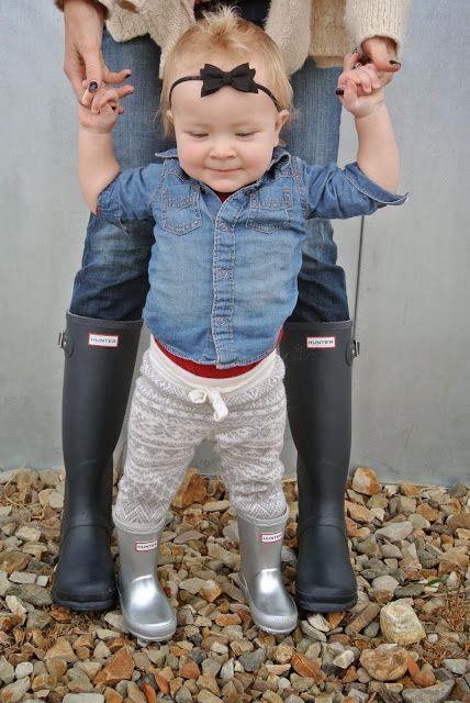 silver baby boots, grey pants, a denim shirt