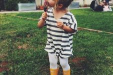 yellow rain boots, a striped tunic and white tights
