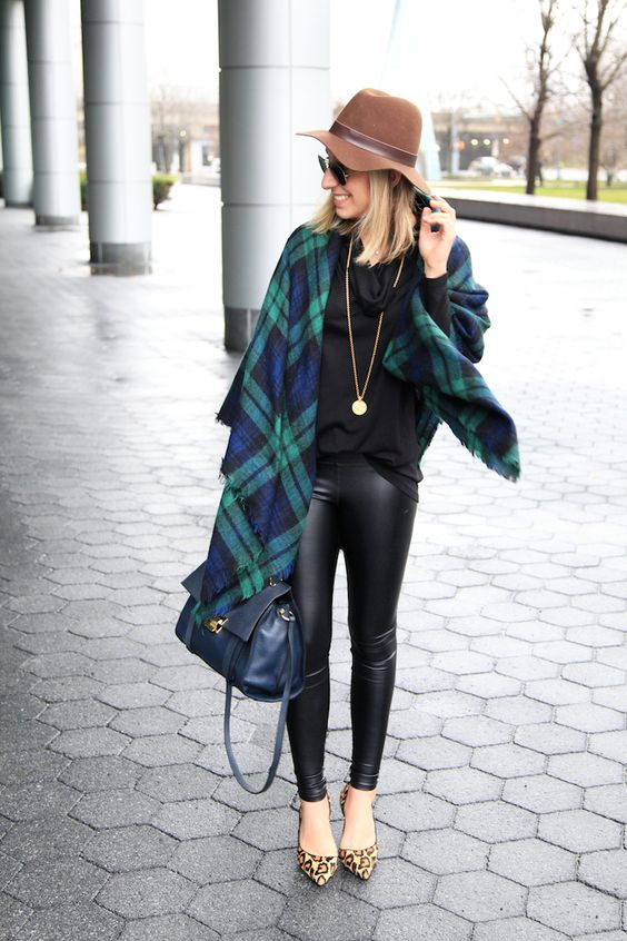 a black sweater, a plaid blanket scarf, a gold pendant necklace, leather leggings, leopard pumps