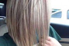 03 asymmetrical blonde bob with darker lowlights
