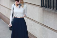 03 navy midi skirt, ankle strap heels, a white shirt are suitable for office