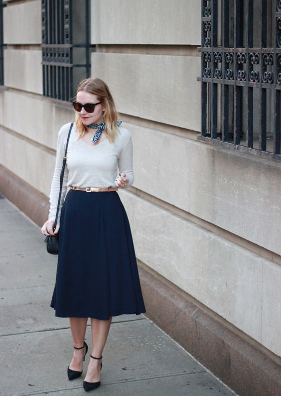 navy midi skirt, ankle strap heels, a white shirt are suitable for office
