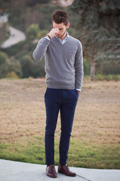 navy trousers, a grey sweater, a light shirt