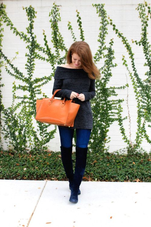 black sweater, blue jeans and black suede tall boots