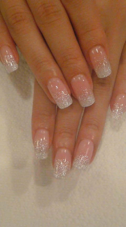 blush nails with silver glitter on the tips