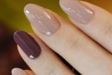05 neutral fall nails with beads and a burgundy accent one