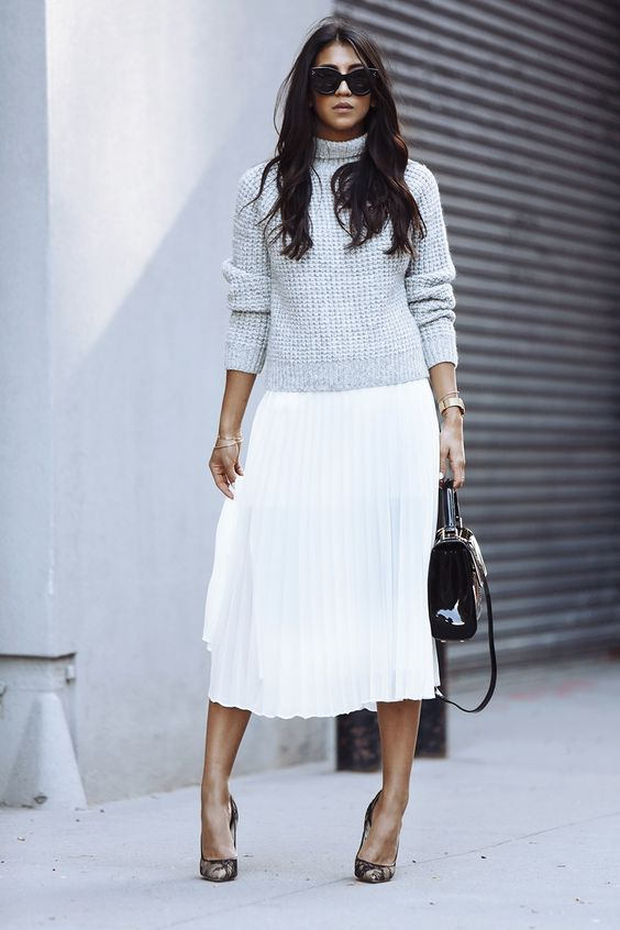 dove grey chunky turtleneck, a white pleated skirt and heels