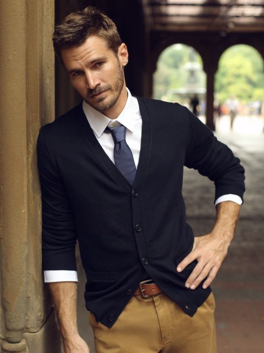 ocher pants, a navy cardigan and a blue tie