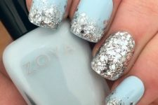07 mint manicure with large silver sequins and an accent nail