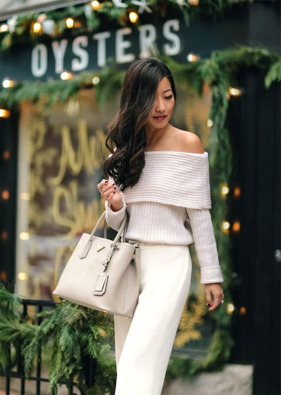 ivory off the shoulder, white pants and a nude bag