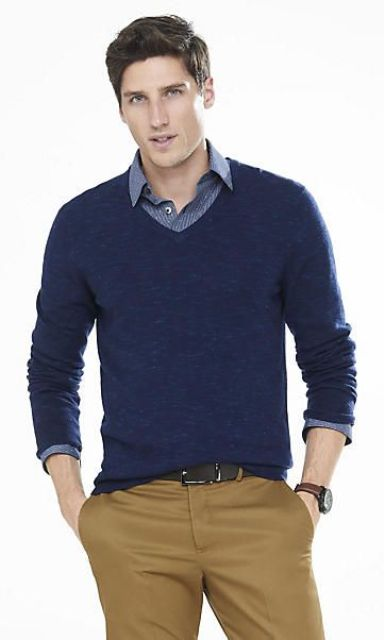 Picture Of yellow trousers a navy sweater and a blue shirt