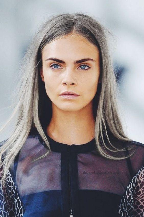 Cara Delevigne rocking light grey straight hair