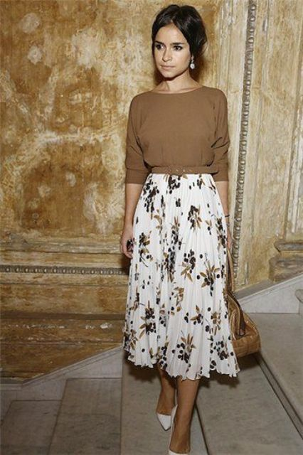 floral midi, a baggy sweater and heels for a vintage styled look