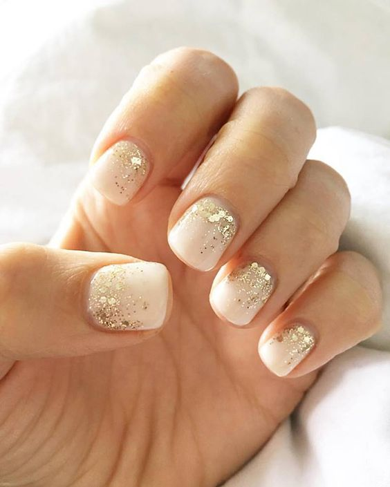 white nails with gold sequins on the nail bed suitable for work