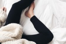 10 black leggings and a chunky knit white sweater for cold seasons