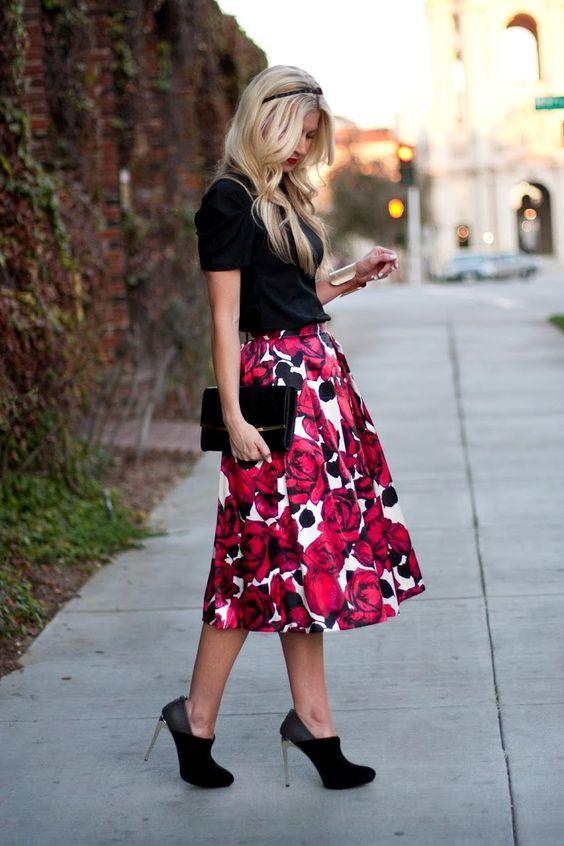 bold floral midi skirt, a black shirt and heels