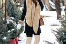 10 ivory over the knee boots, a black coat with faux fur and a cozy beanie