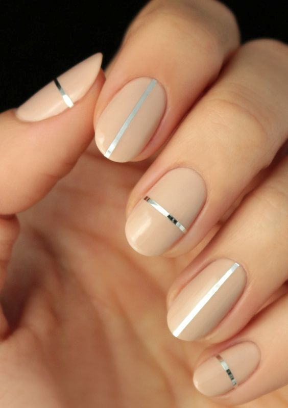 nude nails with silver stickers