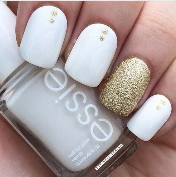 Picture Of white nails with gold glitter dots and a gold accent nail