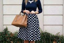 11 a navy turtleneck and a polka dot swing midi skirt, nude heels