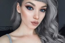 11 silver grey hair looks awesome with pale complexion and blue eyes