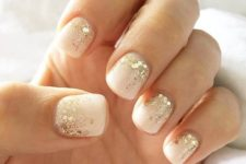 11 white nails with large gold sequins