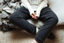 12 black pants, a white printed sweatshirt for feeling cozy