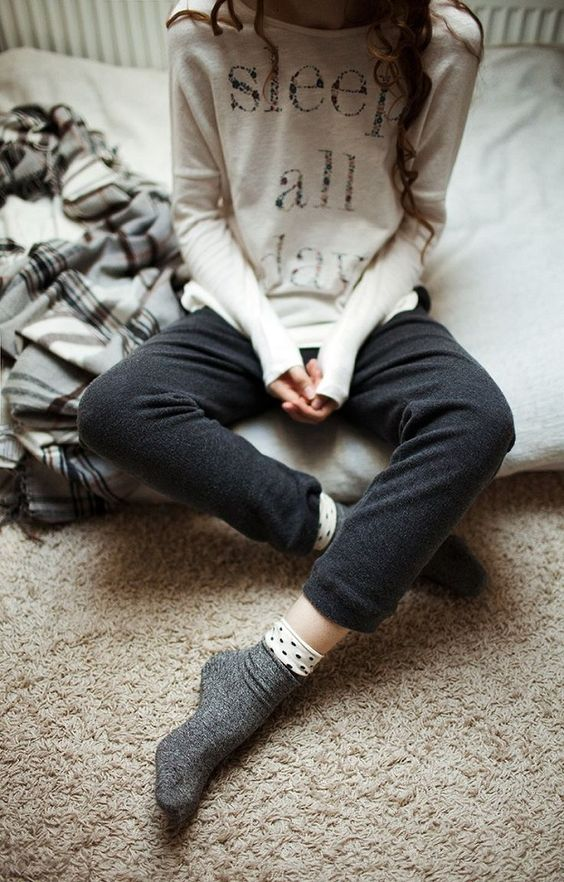 black pants, a white printed sweatshirt for feeling cozy