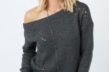 12 off the shoulder sweater with metal rings and black ripped jeans
