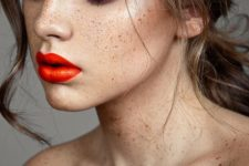 12 orange lips with an olive skin stone