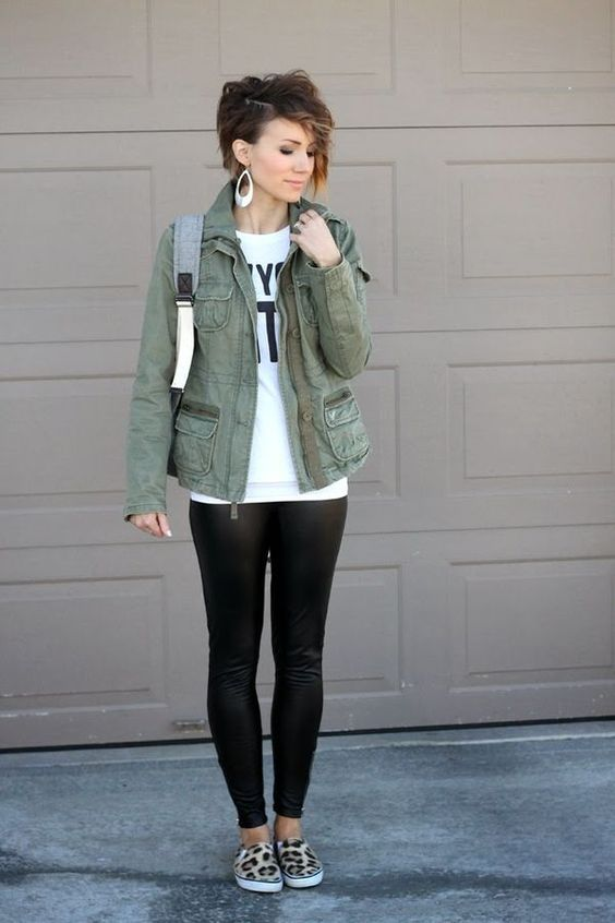 a military jacket, a printed white t-shirt and leopard slip-ons
