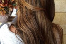 13 chestnut brown hair with golden balayage highlights
