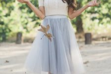 13 grey tulle skirt, a white crop sweater and a statement necklace
