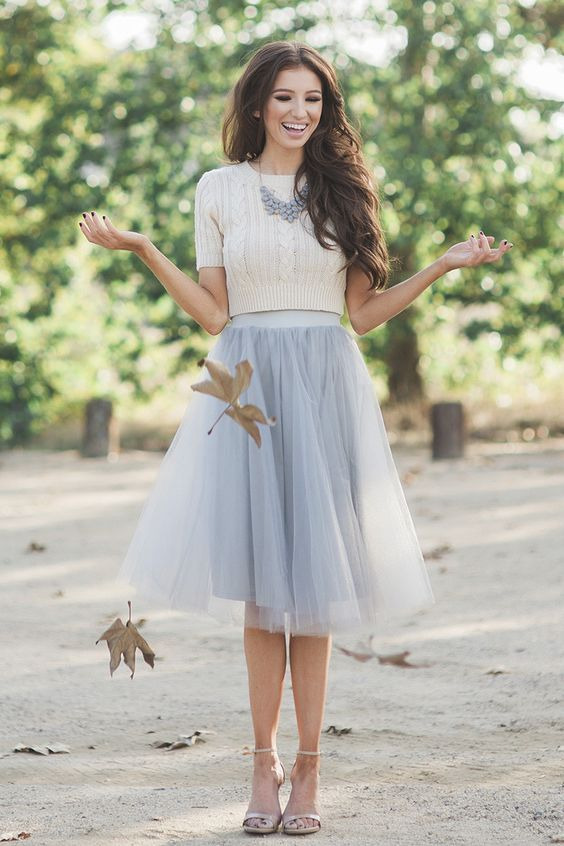 grey tulle skirt, a white crop sweater and a statement necklace