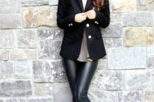 14 a black jacket, a neutral top and ocher boots