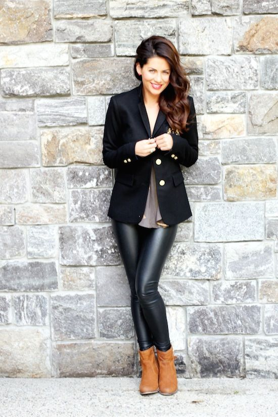 a black jacket, a neutral top and ocher boots