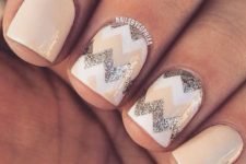 14 cream nails with glitter and wwhite chevrons