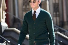 14 green cardigan, grey trousers, a brown tie