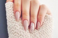 14 long neutral nails with a glitter accent one