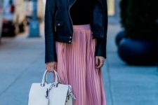 14 pink pleated midi, strap heels, a black turtleneck and a black leather jacket