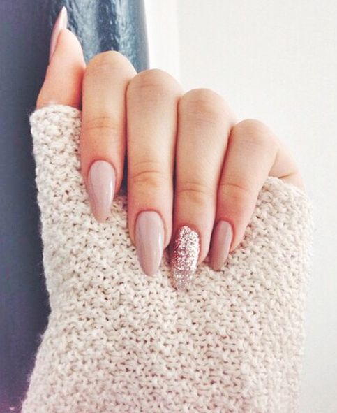 long neutral nails with a glitter accent