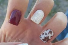 16 fall manicure with red, white and silver nails and a leaf accent nail