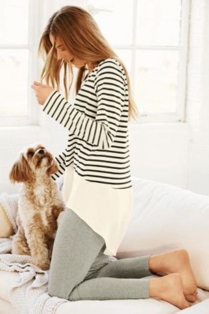 grey leggings, a long striped shirt with long sleeves