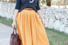 16 yellow pleated midi skirt, a dark grey sweater and flats