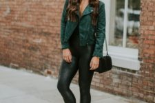 17 black tank top, black faux leather leggings, black heeled booties and a green faux suede moto jacket